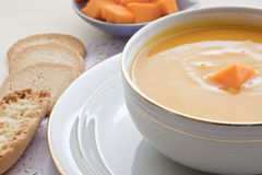 Bowl wiht pumpkin squash soup and bread. Royalty Free Stock Image