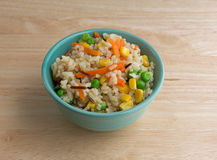 Bowl of wild and brown rice with veggies on table Stock Image
