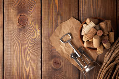 Bowl with wine corks and corkscrew Stock Photography