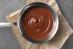 Free Bowl With Tasty Melted Chocolate On Grey Table, Top View Royalty Free Stock Image - 150058306