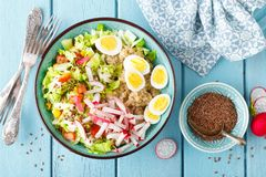 Bowl With Wheat Porridge, Boiled Quail Eggs And Fresh Vegetable Salad Of Radish, Corn, Sweet Pepper And Chinese Cabbage. Healthy A Royalty Free Stock Photos
