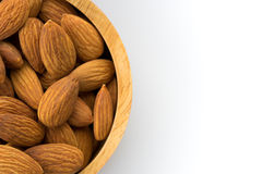 Bowl wood of almonds Royalty Free Stock Images