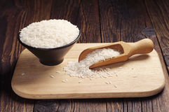 Bowl and wooden spoon with rice Royalty Free Stock Photography
