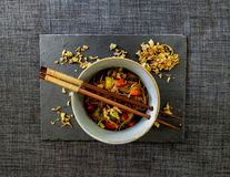 Bowl of yakisoba with fried onion from above stock image