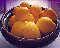 Bowl with yellow harvested lemons Royalty Free Stock Image