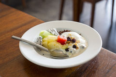 Bowl of yoghurt and fruits Royalty Free Stock Photo