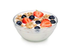 Bowl of yoghurt, with muesli and fruit. Isolated on a white background stock images