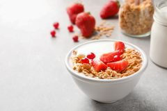 Bowl with yogurt, berries and granola. On table Royalty Free Stock Images