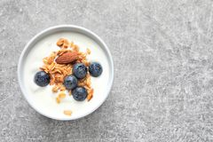 Bowl with yogurt, berries and granola on table. Top view stock photo