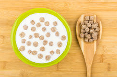 Bowl with yogurt and extruded rye bran and bamboo spoon Stock Image
