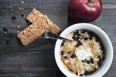 Bowl with yogurt, muesli and honey on floor Royalty Free Stock Images