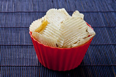 Bowl of yummy chips Stock Photos