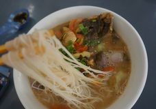 A bowl of yummy fish head noodle stock photo