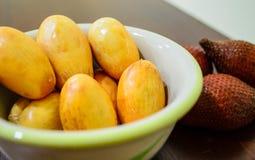 Bowl of Zalacca fruit. Bowl of peeled Zalacca with raw fruit Royalty Free Stock Images