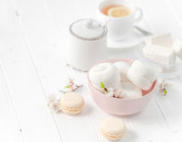 Bowl with zefir, white cup of tea royalty free stock photos