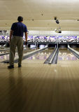 Bowler. Man bowling waits in anticipation for his ball to catch the spare stock image