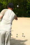 Bowler playing petanque. Man bowling balls in a game of petanque stock photos