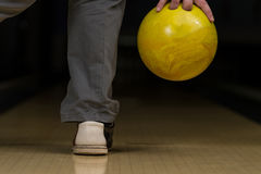 Bowler Attempts To Take Out Remaining Pins Royalty Free Stock Image