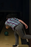 Bowler Attempts To Take Out Remaining Pins Royalty Free Stock Photo