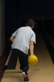 Bowler Attempts To Take Out Remaining Pins Royalty Free Stock Photography