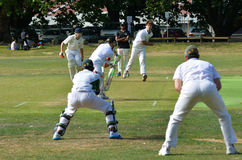A bowler bowling to a batsman. Stock Photos