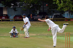 A bowler bowling to a batsman. Royalty Free Stock Images