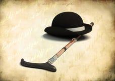 Bowler cap and cane. Retro black bowler cap and cane Stock Photography