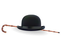 Bowler hat and bamboo cane Royalty Free Stock Photos
