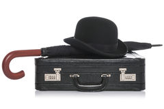 Bowler hat briefcae and umbrella isolated on white. Black leather briefcase with bowler hat and umbrella, isolated on a white background royalty free stock photo