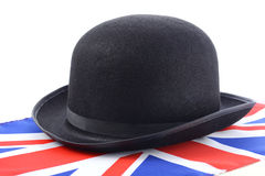 Bowler Hat and English Flag. English UK events concept with bowler hat and Union Jack flag against a white background stock images