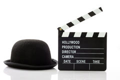 Bowler hat and movie clapper Royalty Free Stock Photo