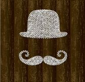 Bowler hat and mustache silhouettes Royalty Free Stock Images