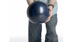 Bowler holding a bowling ball Stock Photo