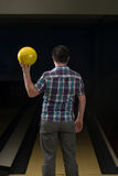 Bowler Poised With His Ball Stock Images