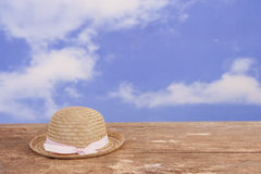 Bowler straw hat lying on an old wooden table Stock Images