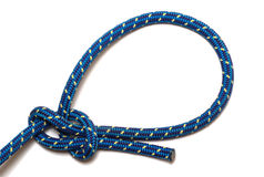 Bowline knot. Made of a blue-yellow rope, isolated royalty free stock photography