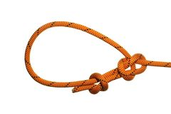 Bowline knot. On orange rope on white background royalty free stock photography
