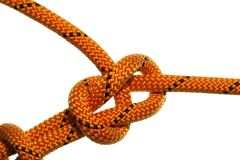 Bowline knot. On orange rope on white background stock image
