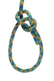 Bowline knot. Bowline loop knot in yellow, blue, and green climbing rope isolated on white stock image