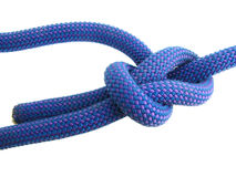 Bowline knot in climbing rope. Bowline knot in blue and purple climbing rope isolated on white stock photography