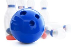 Bowling. Pins and ball for play in bowling on a white background royalty free stock images