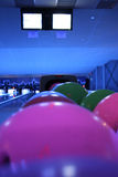 Bowling. Night, multi color balls Royalty Free Stock Photos