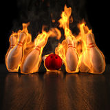 Bowling. Red bowling ball knocks down flaming skittles. 3d illustration Stock Image