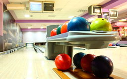 Bowling. Balls in foreground with  lane in background stock image