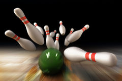 Bowling. Ball crashing into the pins Stock Image