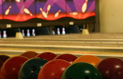 Bowling Abstract. Bowling balls in the foreground, lanes in the background Royalty Free Stock Photos