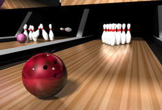 Bowling alley. A red bowling ball rolling down a bowling alley ready to crash into skittles on a bowling alley Stock Photography
