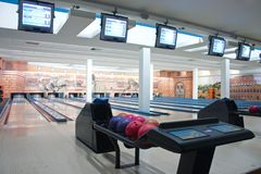 Bowling alley. Empty bowling club with status monitors on top Stock Photo