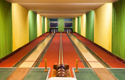 Bowling alley. A Bowling alley with balls and pins Stock Photography