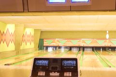 Bowling alley. Lanes in a bowling alley with the scoreboard in the foreground royalty free stock photos